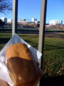 Eating a vegan maple bar in front of my old high school
